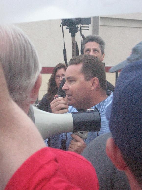 Labor Council Treasurer Richard Barrera speaking to the crowd. Photo: Rich Kacmar