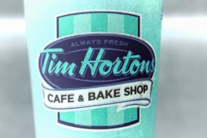 A Tim Hortons coffee cup is seen on the ground outside a shop near Times Square in New York