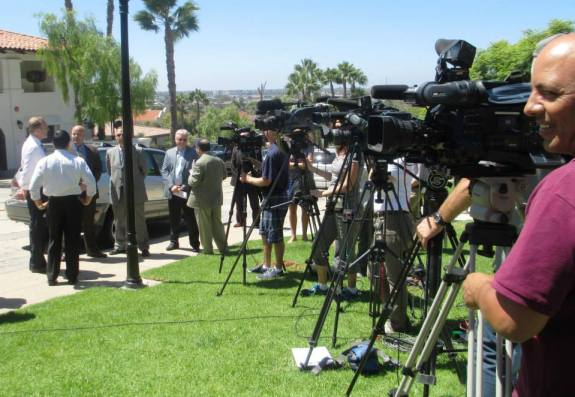 Cameras covering the Juan Street press conference