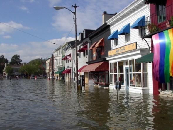 Flooded street with rainbow flag