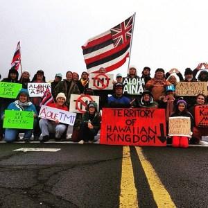 Protectors in the crosswalk of the Mauna Kea access road