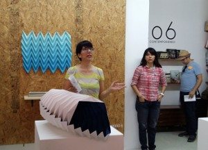 Melisa Arreola speaking to tour group at 206 Arte Contemporáneo