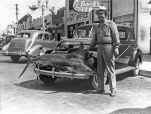 In this photo of Aug. 16, 1940, Verne Spice brings home a swordfish on the front of his car for the free dinner at Dock's.