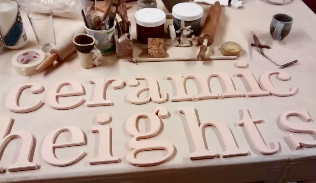 """Ceramic Heights"" sign made of ceramic letters"