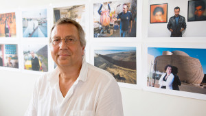 Photographer Stefan Falke in front of images from his project: LA FRONTERA: Artists along the US Mexican Border Photo 2012 © Neil Beckermann