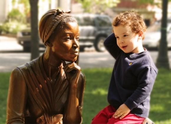 White kid Black statue