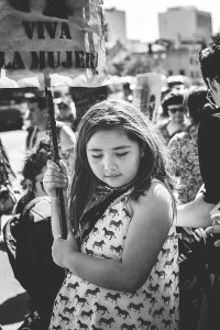 """Young girl carrying """"Viva la mujer"""" sign at the International Women's Day celebration, Los Angeles, CA, March 5, 2016."""