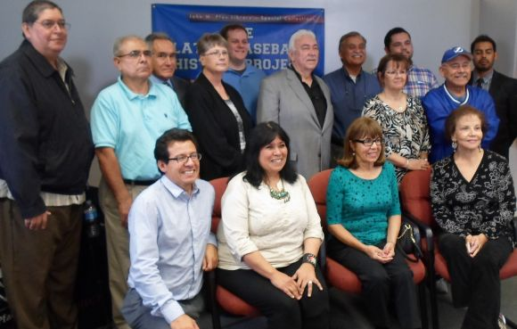 Group picture of contributors to project, author Maria Garcia seated, far right.