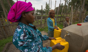 Mairi Tuji of Ethiopia's Kelecho Gerbi village collecting water from the new well. Photo courtesy of Water1st International.