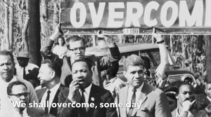 "Martin Luther King, Jr. with Long Island CORE group carrying ""We Shall Overcome"" banner"