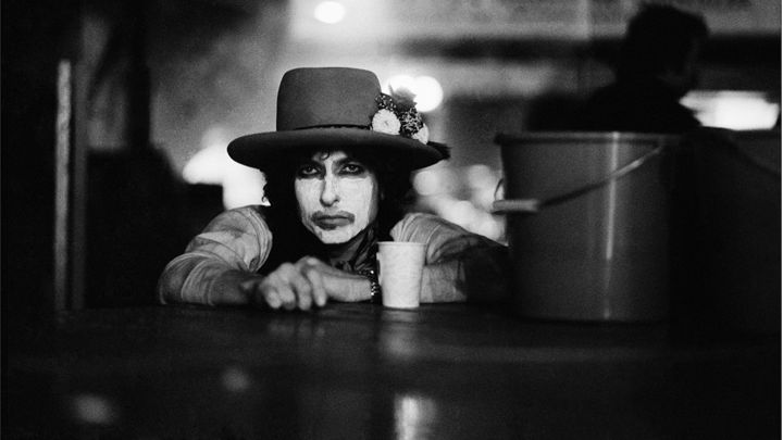 Dylan in whiteface with cup and bucket during 1975 Rolling Thunder Revue tour