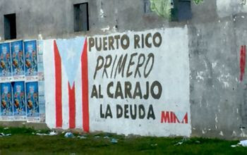 """Graffito in Trujillo Alto: """"Puerto Rico first. To hell with the debt."""" Photo: Ed Morales"""