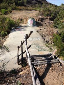 Sewage infrastructure doubles as a pedestrian trail in Juniper Canyon; Ranger Jason Allen constructed this staircase with reused eucalyptus wood from the canyon.