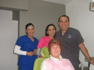 Dr. Garcia & staff with Judy