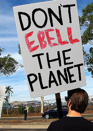 "Man with sign ""Don't Ebell the planet"""