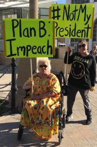 Two participants at a San Diego rally to protest Electoral College vote, Dec. 19th, 2016. (Photo: Annie Lane)