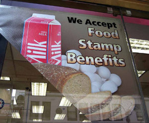 "Poster in store window ""We Accept Food Stamp Benefits"