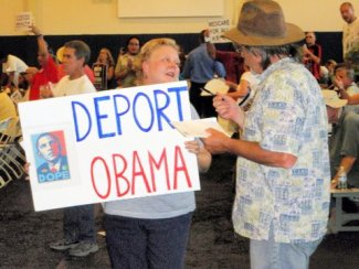 "Woman holding ""Deport Obama"" sign being interviewed"