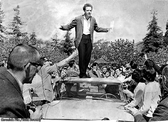 Mario Savio standing on police car during UC Berkeley Free Speech Movement rally, 1964