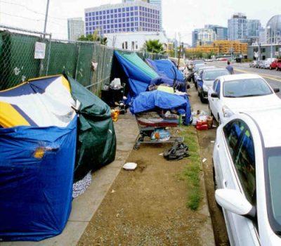 Tents set up along sidewalk downtown San Diego
