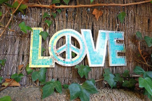 Sign: LOVE with a peace sign for the letter O