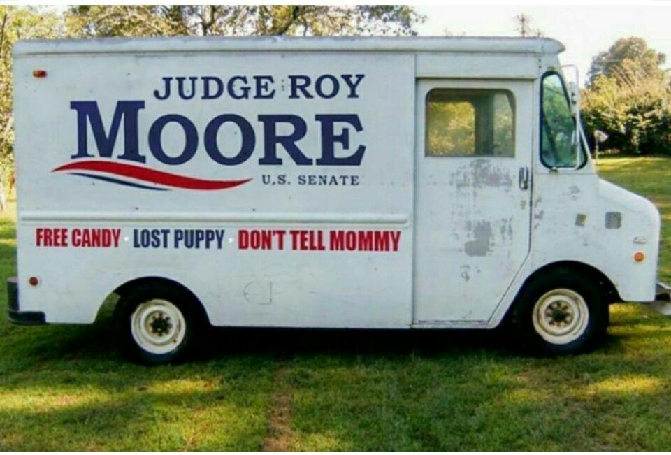 Panel truck with campaign signs for Judge Roy Moore