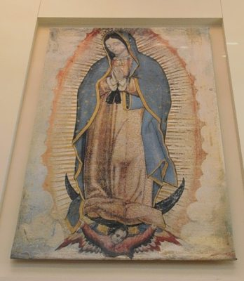 Painting of Our Lady of Guadalupe in wall alcove