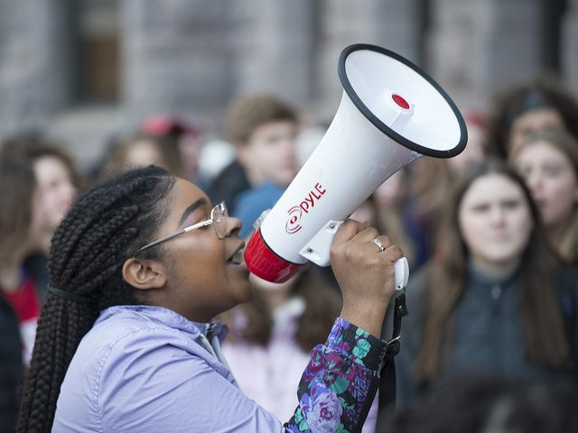 Young woman speaking with bullhorn