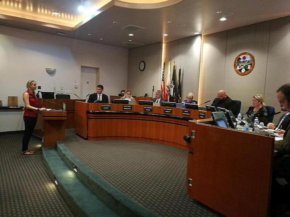 Speaker at podium and La Mesa City Council in chambers