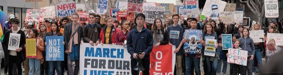 Large crowd of youth holding signs at March For Our Lives rally