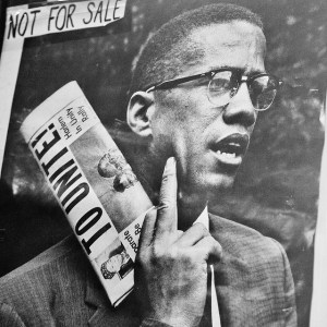 """Photo of Malcolm X poster labeled """"NOT FOR SALE"""""""