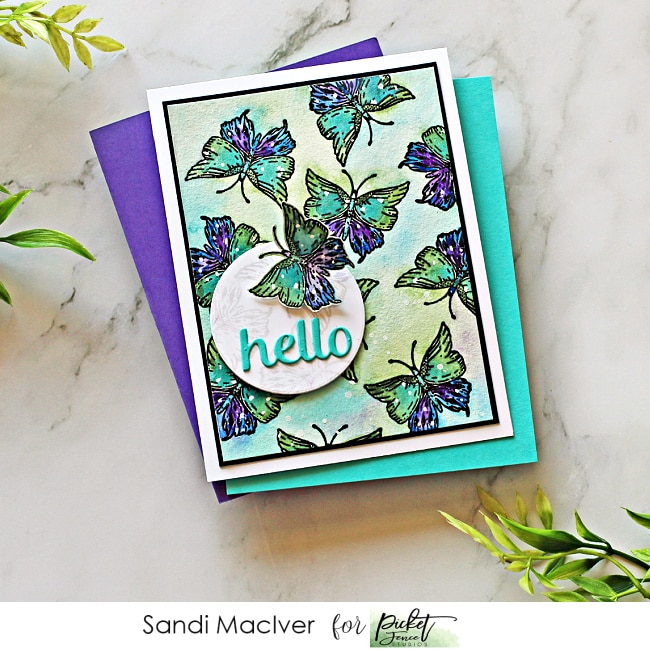 picture of a handmade card covered in butterflies in blue and purple