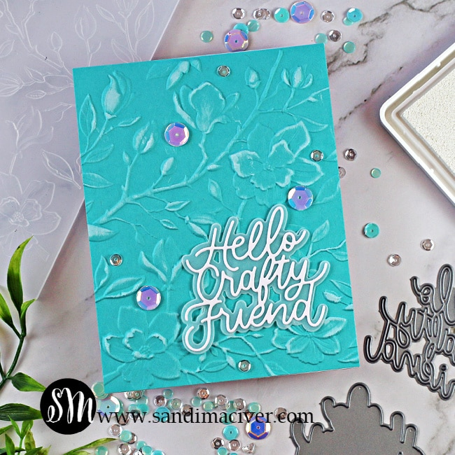 a blue handmade greeting card embossed with the Simon Says Stamp Magnolia