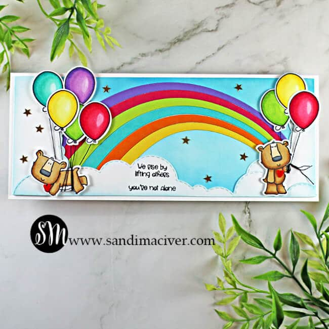 handmade slimline card with a rainbow and two bears holding balloons using stamps and cardmaking products from Trinity Stamps