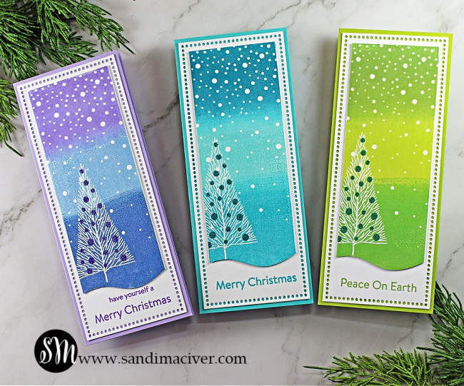 three slimline cards with ink blended backgrounds and white embossed trees created with cardmaking products from Simon Says Stamp