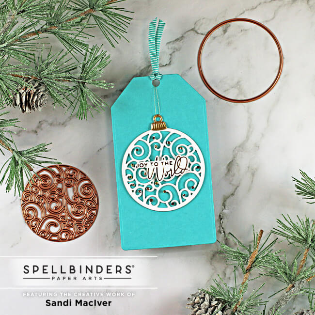 christmas gift tag with a decorated die cut ball on the front using dies from Spellbinders