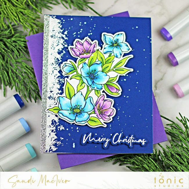 Navy hand made card with blue and purple colored flowers on the front created with paper crafting supplies from Tonic Studios