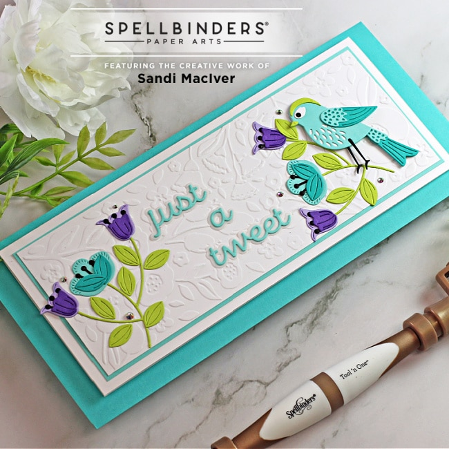 handmade slimline card with a bird and flowers created with paper crafting dies from Spellbinders
