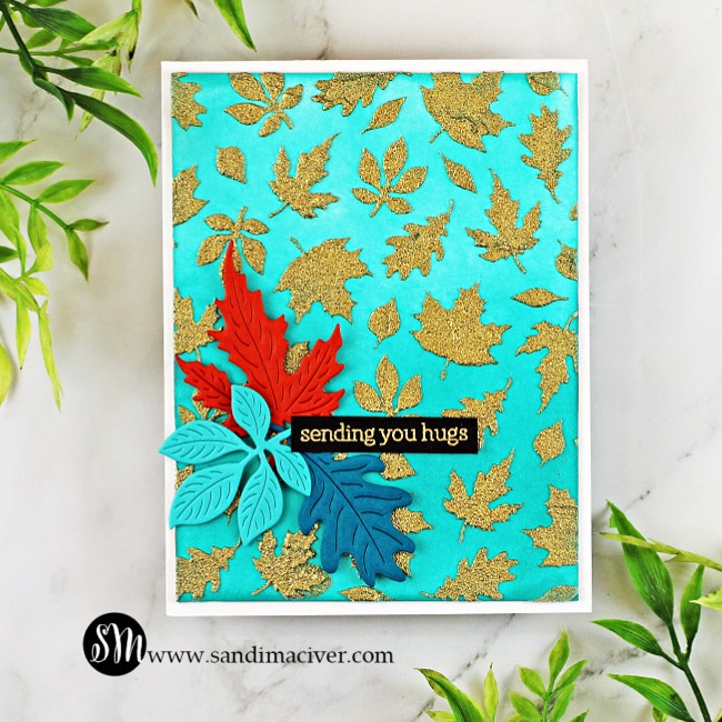 handmade card covered in fall leaves using stencils and dies from Hero Arts