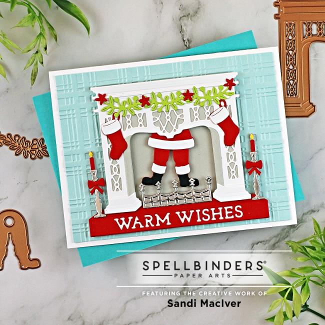handmade greeting card with santa coming down the chimney using new die cutting paper crafting products from Spellbinders