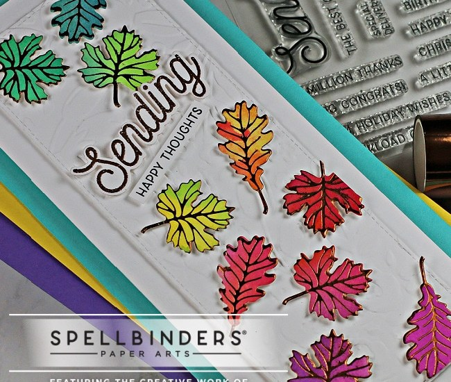 handmade slimline card covered in a rainbow of fall leaves using paper crafting products from Spellbinders