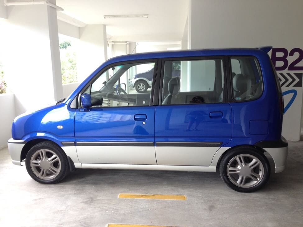 blue boxy car: cost of living in Penang