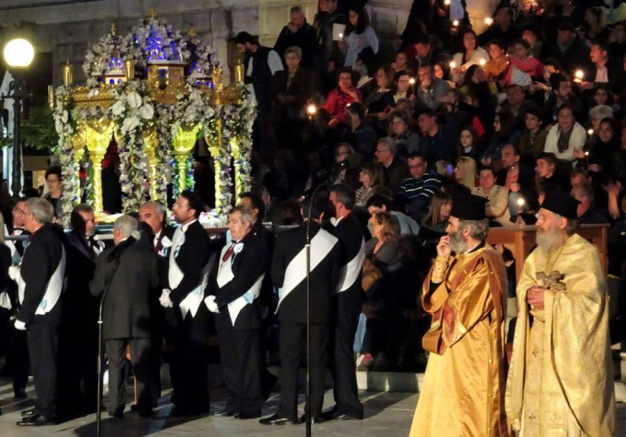 Priests watching the Holy Biel arrive, Syros, Greece