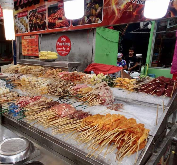 Food stall-food on sticks. Starting a new life abroad