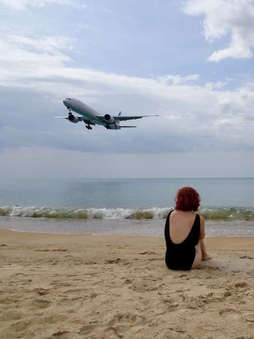 Plane landing overhead while I sitting on beach-unusual things to do in Phuket