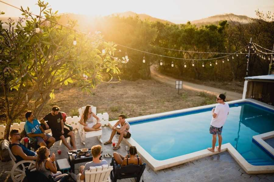 Friends sitting around a pool-starting a new life abroad