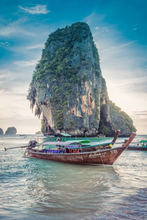 Limestone Karst with Thai wooden boat