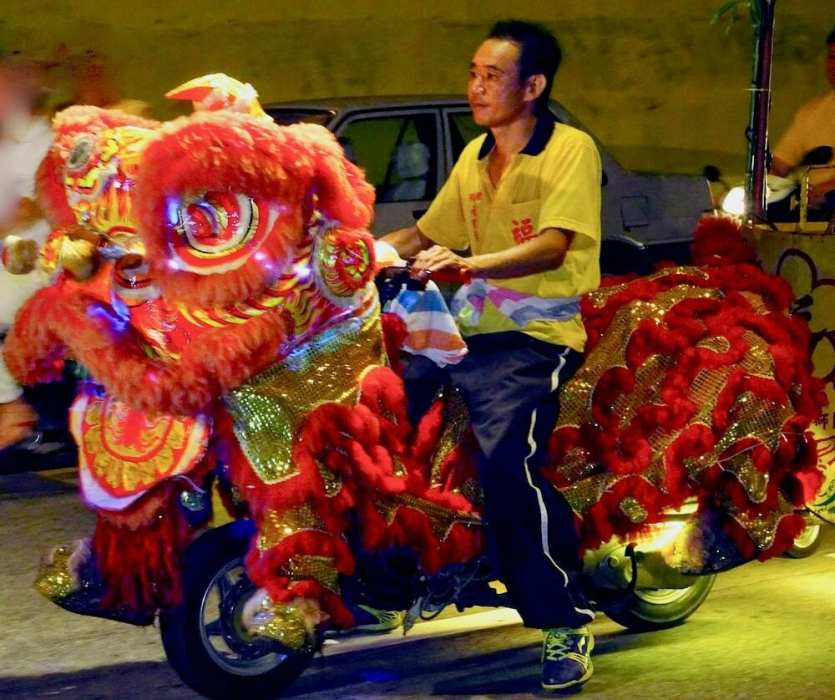 Man riding a Lion Dance scooter-reasons to visit Malaysia