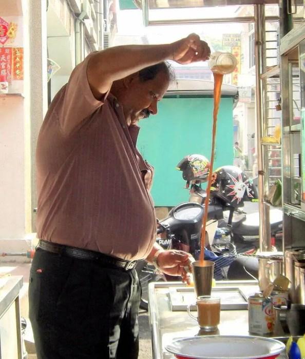 man pulling tea
