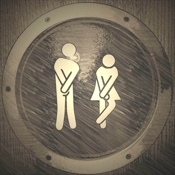 "toilet sign. male and female ""holding it"". Interesting facts about Malaysia"